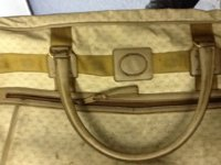 4. Gucci Luggage - large suitcase front close up.jpg
