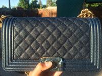 cee5746a149b Navy caviar boy bag has faded coloring on edges