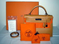 HERMES KELLY GOLD.jpg