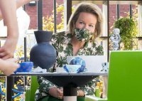 queen-mathilde-in-natan-floral-blouse-and-mask-2.jpg