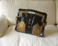 HH floripa clutch on sofa front crop.jpg